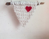 Crochet banner with eggshell and gold embellished yarn. Small red heart accent. Handmade