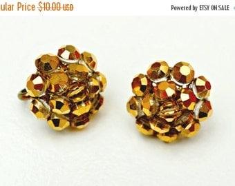 vogue earrings metallic gold bead cluster clip on earrings