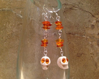 Amber and skull dangle earrings