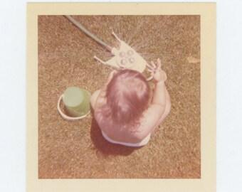 Vintage Snapshot Photo: Baby & Garden Sprinkler, c1960s (69498)