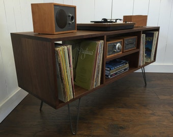 Mid century modern record player console, turntable, stereo cabinet with LP album storage featuring black walnut with steel hairpin legs.