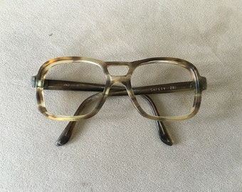 American Optical Mad Men Era smokey gray and clear with metal details at the temples.  vintage 1950's - 1960's