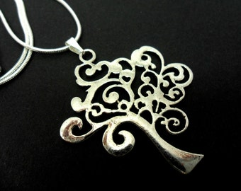 A lovely tree of life   themed  tibetan silver   pendant necklace.