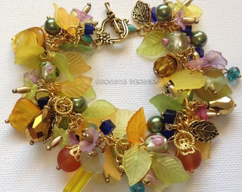 Sold    Pretty Spring Garden Themed Bracelet .