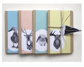 Blank moleskine journal with Hunting Party animals on cover