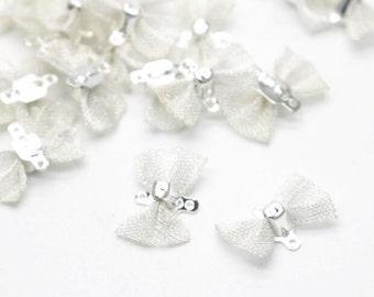 24 pcs of filigree bow charm 15x9mm-silver