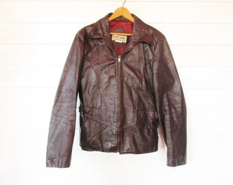 A 'Chess King' Deep Burgundy Leather Jacket - 36R? or Medium - Made in Korea - Satin Lining - Buckled Strap Back - Zipped Front