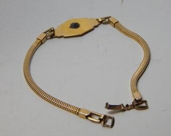 Gold over silver signet bracelet.  Generous length. Great for Medical Alert Symbol.