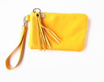 Yellow leather wristlet or clutch.   A sunny, daisy handbag.