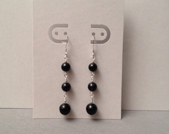 Sterling silver wire wrapped earrings with black agate.