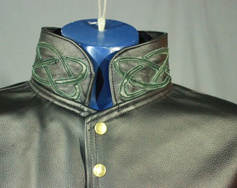 Leather dress coat with celtic highlights in forrest green.