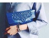 Vegan bag / blue clutch purse / slim clutch bag / classic envelope shape / floral brand in vinyl / standout accessory / we are vegan