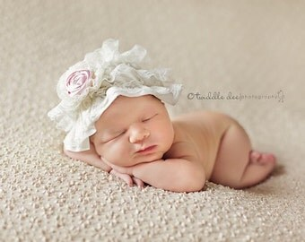 Lace baby hat with rosette flower