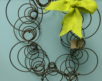 Vintage bedspring wreath. Can be detached to separate.