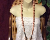 Flesh pink colored tagua nut vegetable ivory beads discs necklace.