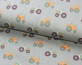 Tractors on green cotton lycra jersey knit fabric - UK seller