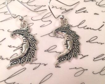 Crescent moon earrings.