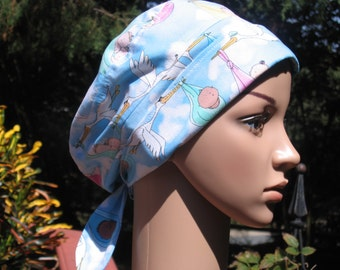 Scrub caps for ladies or gents in Stork Special Delivery print.