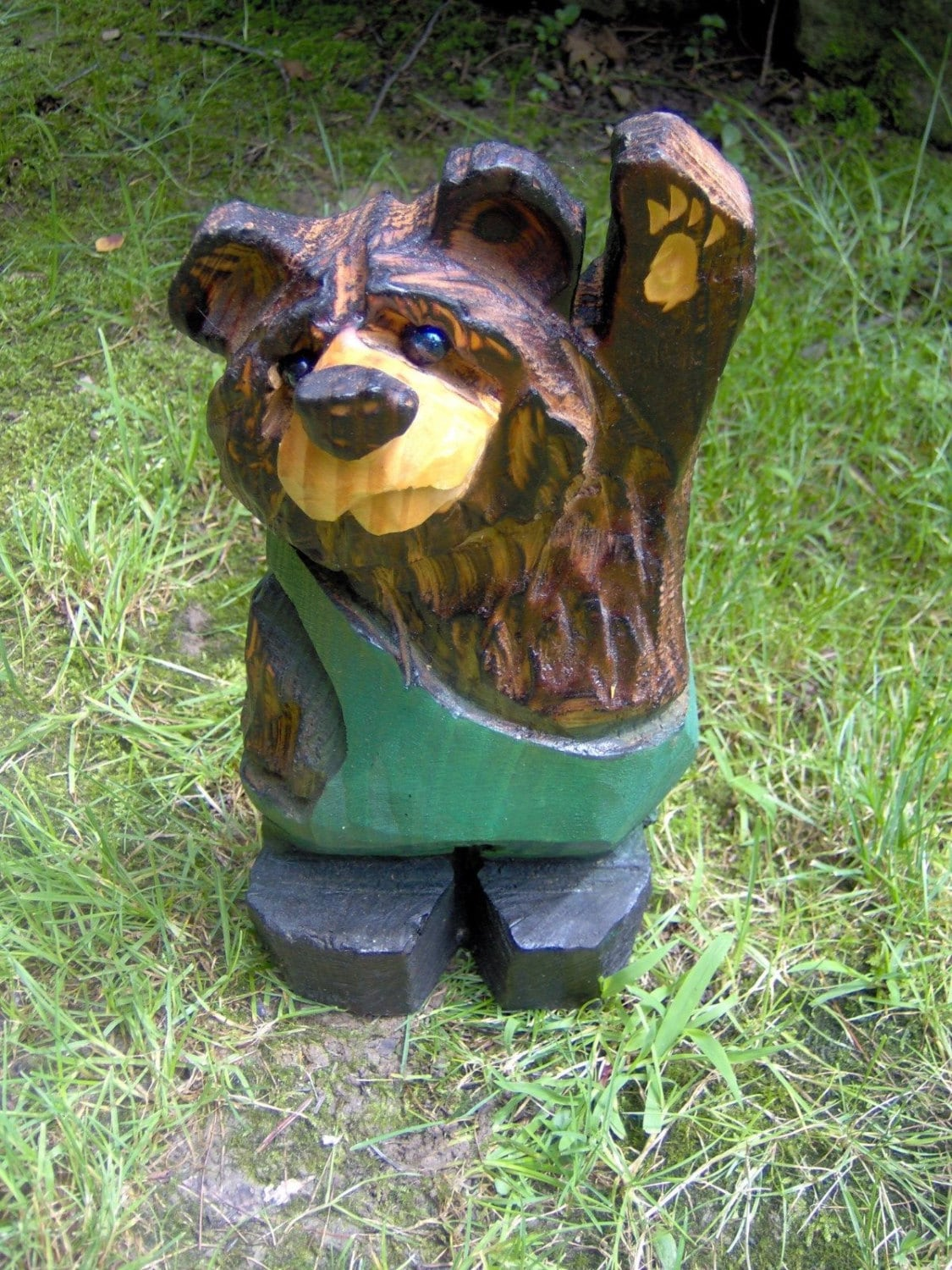 Chainsaw carved wood bear in overalls
