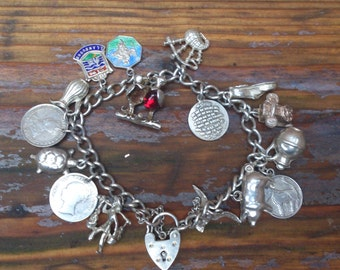 vintage sterling silver charm bracelet with 15 coins and charms