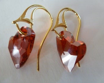Have A Heart Earrings are red Swarovski hearts swinging at a jaunty angle from dimensional Vermeil French Eurowires