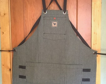 Striped raw denim woodshop apron with adjustable crossed straps. Woodworker's apron, wood shop apron, waxed canvas apron