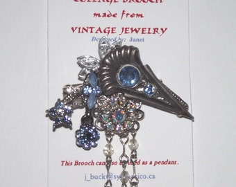 Color Theme / Blue.  1-of-a-Kind collage brooch / pendant, made from recycled vintage jewelry.  Rhinestones, dangles, silver.  #89.
