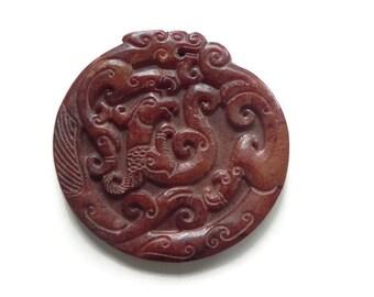 1 carved jade dragon pendant
