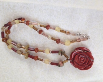 Carved rose stone pendant necklace