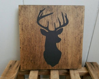 Small deer silhouette wall art on wood