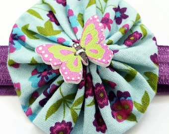 Butterfly yo-yo headband.  Aqua and purple elastic headband