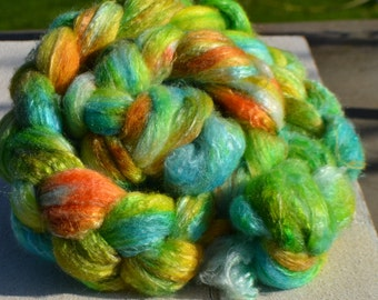 Strand of wool spinning and felting green, turquoise and orange
