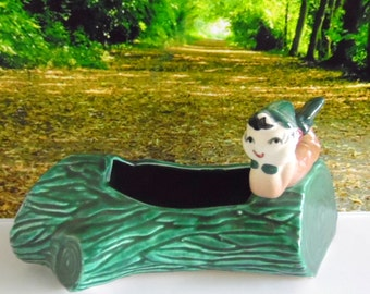 Vintage, 1940-50s Pixie/ Elf/ gnome planter.  Pixie is laying on a green log that forms a small planter, garden planter.