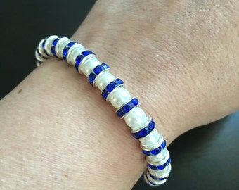 "The ""Blue Satin"" Bracelet is Adorned with White Pearl Style Beads and Sapphire Blue Spacers"