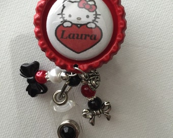 Red hello kitty badge reel