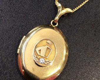 Locket with a jockey on the front