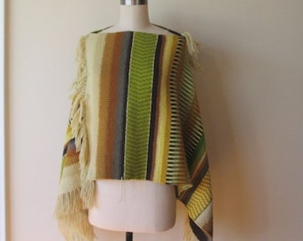 Vintage hand/loom woven Poncho with fringe and bateau neckline