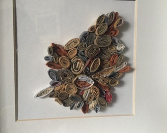 Framed paper collage. Recycled rolled paper art.