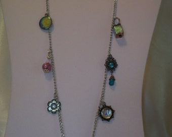 Long pendant with Charms
