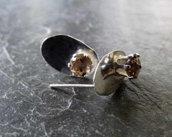 Polished sterling silver ovals set with faceted smokey quartz