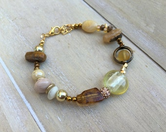 Mixed media beaded bracelet gold colored, natural stone, glass beads