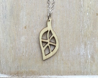 Short silver necklace with laser cut wooden leaf charm
