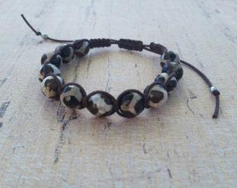 Brown beaded macrame bracelet.