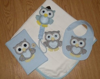 Set for baby: diaper, tape to pacifier, bib and Briefcase