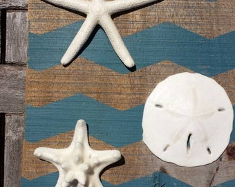 One of a kind upcycled pallet wood sign with painted chevron stripes and adorned with 2 real starfish and 1 sand dollar.