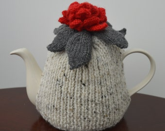 Tea Cosy with red flower embellishment.