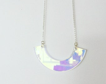 Laser cut Saturn iridescent acrylic necklace