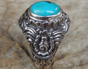 Silver ring flower motif with turqouis stone