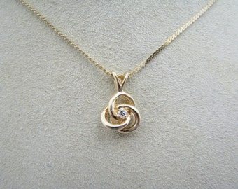 Beautiful Diamond Pendant with (3) Entwined Circles of Gold