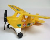 Vintage 1976 Fisher Price 307 Ranger Adventure People Wilderness Patrol Plane Toy Yellow Green Red Decals Propeller Spins Wheels Turn EUC
